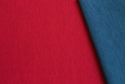 Red and blue color folded fabric cloth texture background
