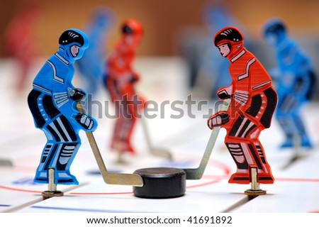 Red and blue figures of hockey players of children\'s board game