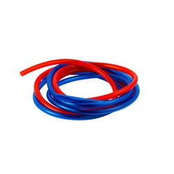 Red and blue hose twisted into a roll on a white background