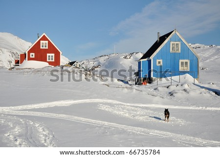 Red and blue house in the Kulusuk village, Greenland