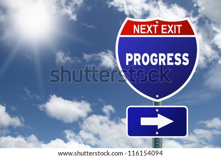Red and blue interstate road sign Next Exit Progress