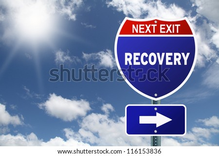 Red and blue interstate road sign Next Exit Recovery - stock photo