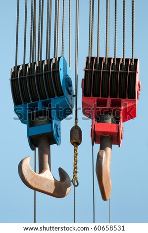 red and blue lifting hooks