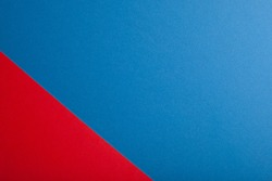 Red and blue paper background, texture, copy space.