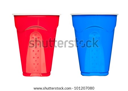 Red and blue plastic, disposable  drinking cups, typically used at picnics and parties, isolated on white.