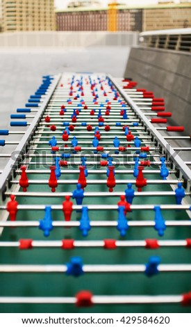 red and blue table soccer players, selective focus. #429584620