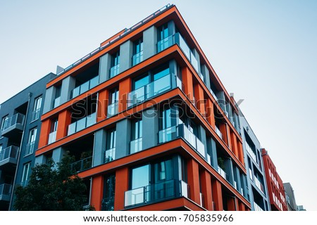 red and futuristic architecture of apartment house #705835966