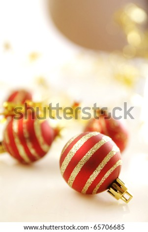 Red and gold christmas balls on a table