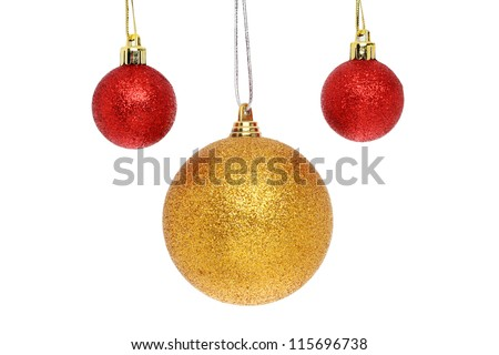 Red and gold Christmas baubles isolated against white