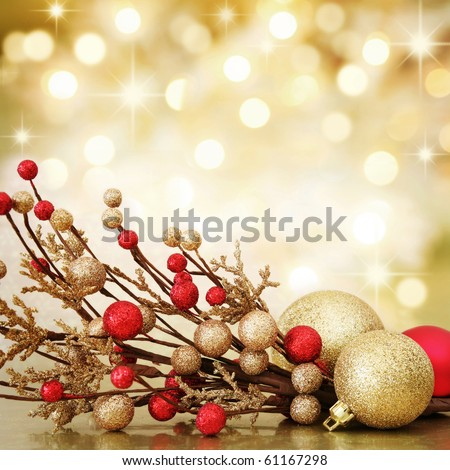 Red and gold Christmas baubles on background of defocused golden lights. Shallow DOF.