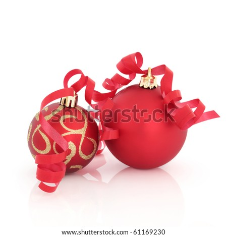 Red and gold christmas decorations with ribbon isolated over white background.
