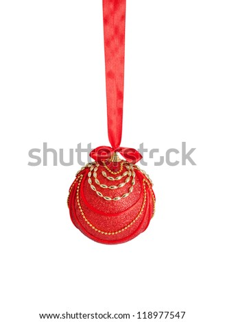 Red and gold Christmas fur-tree decoration ball with satin ribbon and bow. Isolated on white background