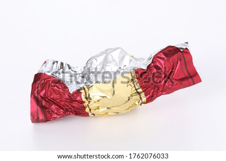 red and gold empty candy wrapper isolated on white background with copy space for your text ストックフォト ©