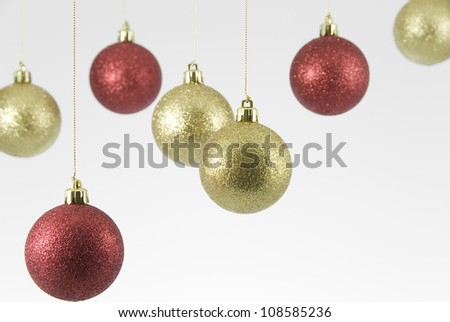 Red and Gold Hanging Christmas Decorations on White Background