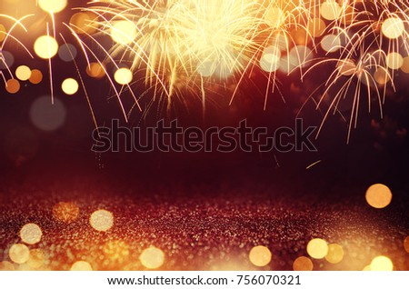 Red and Gold Vintage Fireworks and bokeh in New Year eve and copy space. Abstract background holiday.