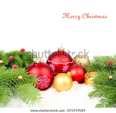 Red and golden Christmas balls and branches of a Christmas tree on snow on a white background. A Christmas background with a place for the text. #291959069