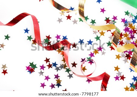 red and golden ribbons and small confetti stars, party time