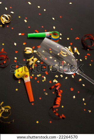 red and golden spirals, small confetti stars, blowers and flute , party time