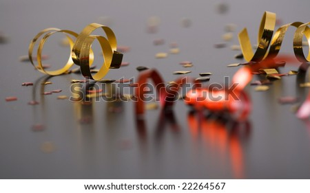 red and golden spirals, small confetti stars, party time
