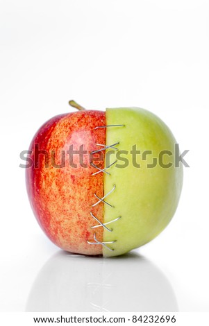 red and green apple putted togetherr with a sulture