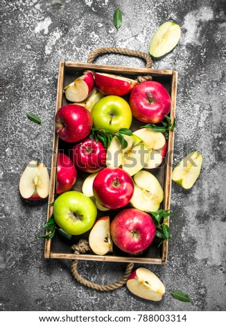 Red and green apples in a wooden tray. On a rustic background. - Shutterstock ID 788003314