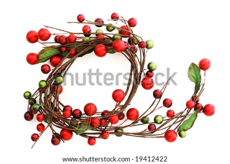 Red and green berries Christmas wreath isolated on white