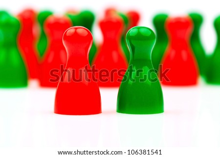 red and green characters. coalition government between red and green. - stock photo