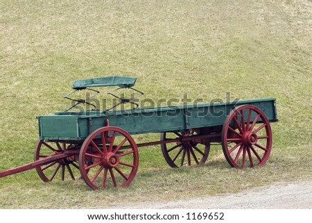 Red and green horse drawn wagon