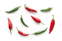 Red and Green hot chilli peppers isolated. Food background. Top view.