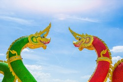 Red and green King of Nagas statue at Wat Saman Ratanaram in Chachoengsao, Thailand