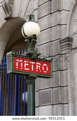 Red and green metro sign in Paris France