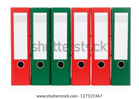 red and green ring binders in a row on white background - stock photo