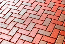 Red and grey paving stones as background close up