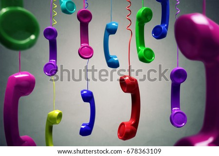 Red and multi-coloured telephone receiver hanging over gray background concept for on the phone, customer service, on hold or contact us #678363109