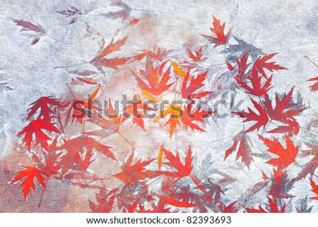 Red and orange leaves on grunge texture