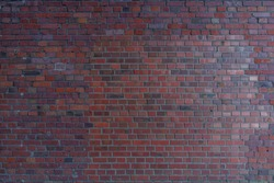 Red and orange tone vintage Bumpy, rough and old brick texture with  English brick bond pattern.