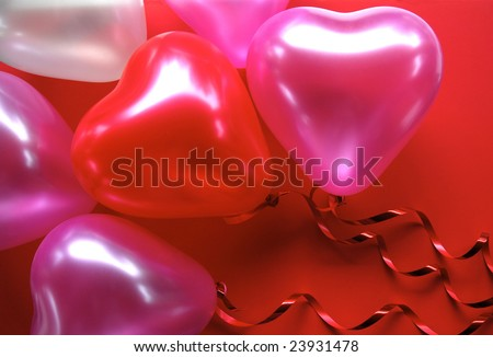 Red and Pink Heart shaped Balloons on a red background