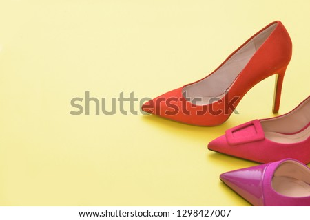 2be7324c071 Red and pink high heels isolated on a bright yellow background. Fashion  concept