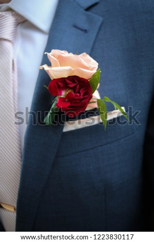 7c2cf1a8f0d4 Red and Pink Rose Groom's Wedding Boutonniere on a Blue Suit with a Pink Tie  and