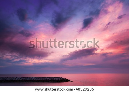 Red and Purple sky over Atlantic Ocean