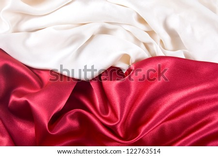 red and white background with a red and white satin