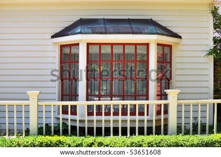 Red and white bay window