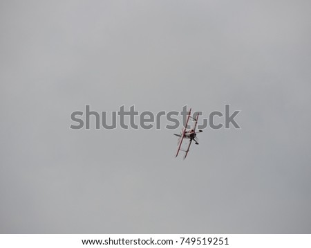 red and white biplane about to...
