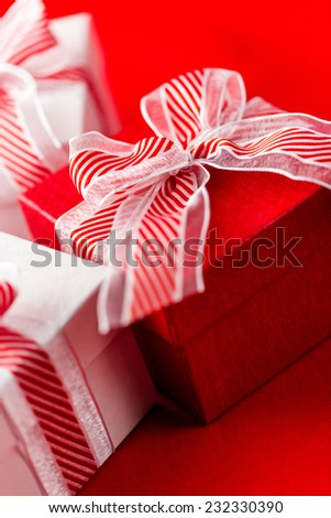 Red and white boxes with Christmas gifts.