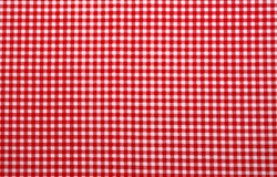 Red and white checkered tablecloth. Top view table cloth texture background. Red gingham pattern fabric. Picnic blanket texture. Red table cloth for Italian food menu. Square pattern of gingham.