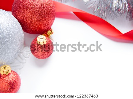 Red and White Christmas balls and red ribbon whith space for text. Christmas decoration