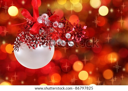 Red and white Christmas tree decorations on lights background