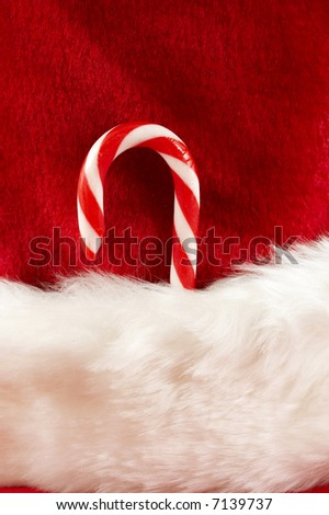 red and white colors macro of christmas stocking with candy cane