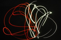 red and white colour light painting in Black background.