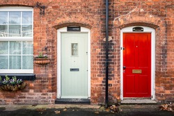 Red and white doors with brick wall at England, UK.